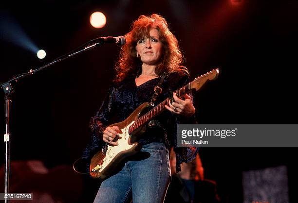 Musician Bonnie Raitt performs at Farm Aid in the Hoosier Dome Indianapolis Indiana April 7 1990