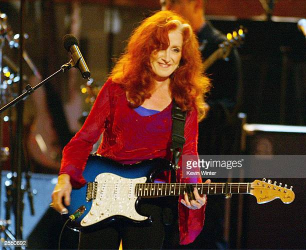 Musician Bonnie Raitt performs on stage during the WOMEN ROCK Songs from the Movies the fourth annual concert for the fight against breast cancer at...