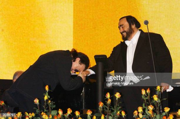 Musician Bono of U2 bows before opera singer Luciano Pavarotti during the Pavarotti and Friends 2003 concert May 27 2003 in Modena Italy This year's...