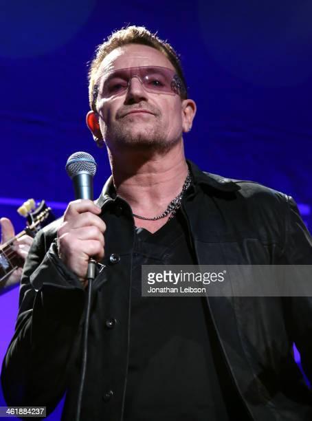 Musician Bono of U2 performs onstage during the 3rd annual Sean Penn Friends HELP HAITI HOME Gala benefiting J/P HRO presented by Giorgio Armani at...