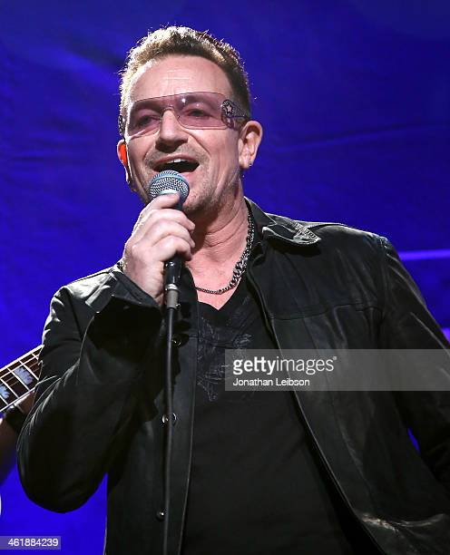 Musician Bono of U2 performs onstage during the 3rd annual Sean Penn Friends HELP HAITI HOME Gala benefiting J/P HRO presented by Giorgio Armani at...