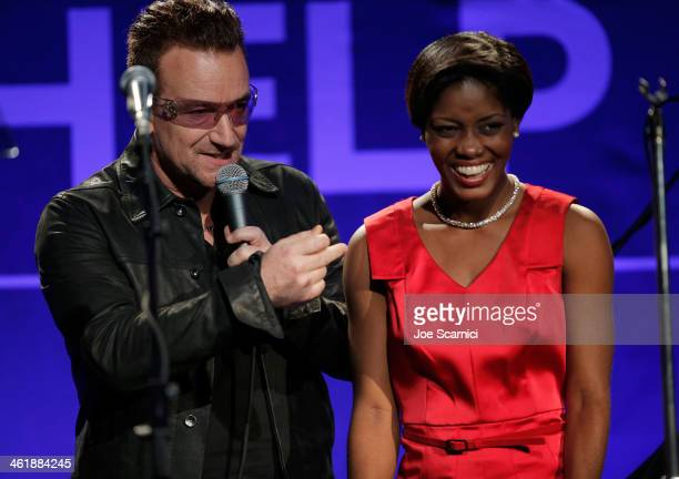 Musician Bono of U2 performs with Anaelle JeanPierre onstage during the 3rd annual Sean Penn Friends HELP HAITI HOME Gala benefiting J/P HRO...