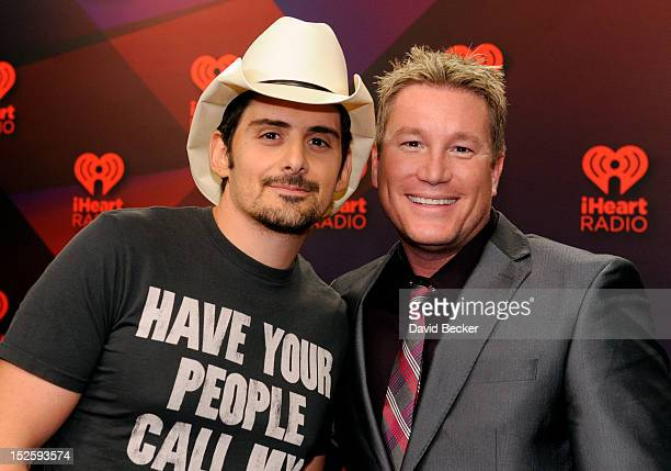 Musician Brad Paisley and radio host Boxer pose in the Elvis Duran Broadcast Room during the 2012 iHeartRadio Music Festival at the MGM Grand Garden...