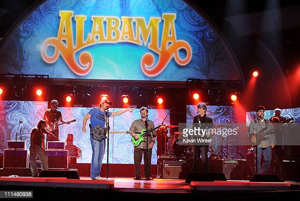 Musician Brad Paisley Jeff Cook and musicians Randy Owen and Teddy Gentry from the band Alabama perform during rehearsals for the 46th Annual Academy...