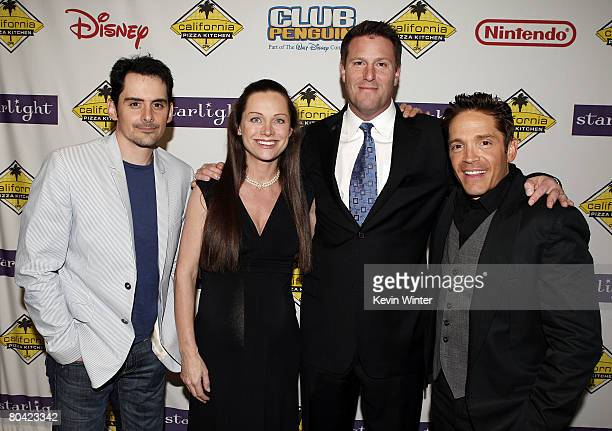 Musician Brad Paisley Lisa Mayer and Kevin Mayer Exec VP Walt Disney Company and musician Dave Koz pose at the Starlight Starbright Children's...