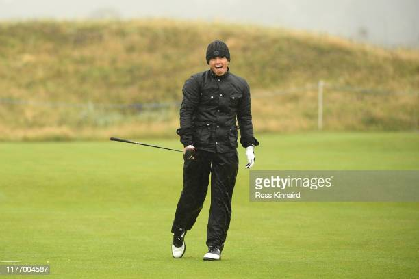Musician, Bradley Simpson reacts after he plays a shot during preview for the Alfred Dunhill Links Championship at Carnoustie Golf Links on September...