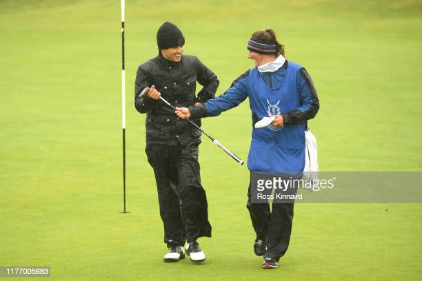 Musician, Bradley Simpson reacts after he putts during preview for the Alfred Dunhill Links Championship at Carnoustie Golf Links on September 25,...