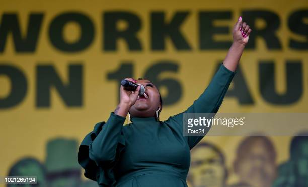 Musician Brenda Mtambo performs during an event to commemorate the sixth anniversary of the Marikana massacre on August 16, 2018 in Rustenburg, South...