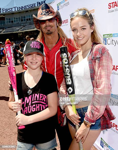 Musician Bret Michaels poses with daughters Jorja Sychak and Raine Sychak during the 26th Annual City of Hope Celebrity Softball Game at First...