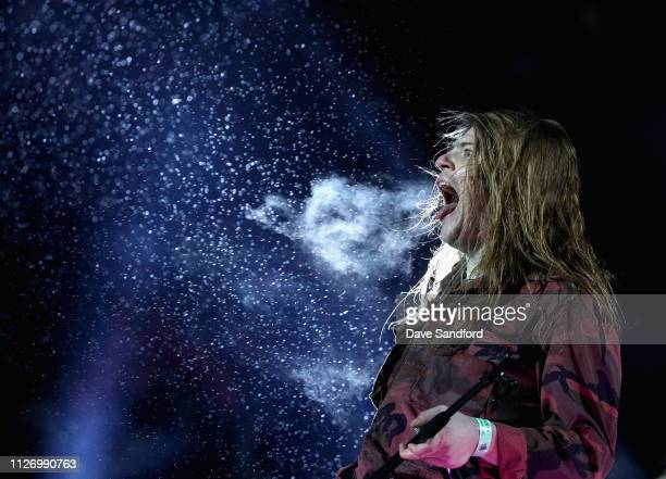 Musician Brett Emmons of The Glorious Sons performs during the second intermission of the 2019 Coors Light NHL Stadium Series game between the...