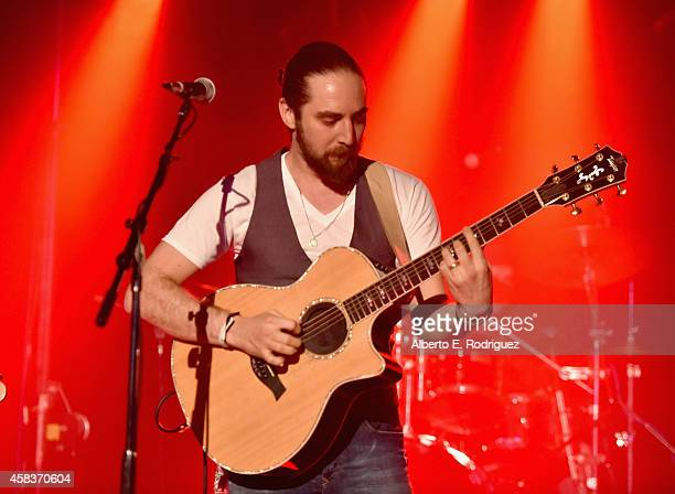 Musician Brian Buckley attends the CW's Fan Party to Celebrate the 200th episode of 'Supernatural' on November 3 2014 in Los Angeles California