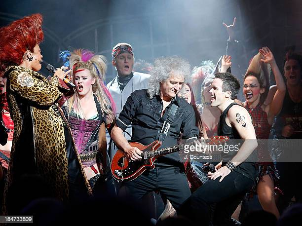 """Musician Brian May and actor Brain Justin Crum perform onstage with the cast of """"We Will Rock You"""" during the """"We Will Rock You"""" National Tour..."""