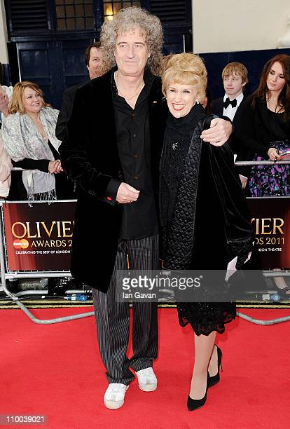 Musician Brian May and actress Anita Dobson attend The Olivier Awards 2011 at Theatre Royal on March 13 2011 in London England