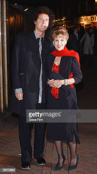 Musician Brian May and actress Anita Dobson attend the UK Premiere of Charlie at the Warner Village Cinema West End on February 2 2004 in London...