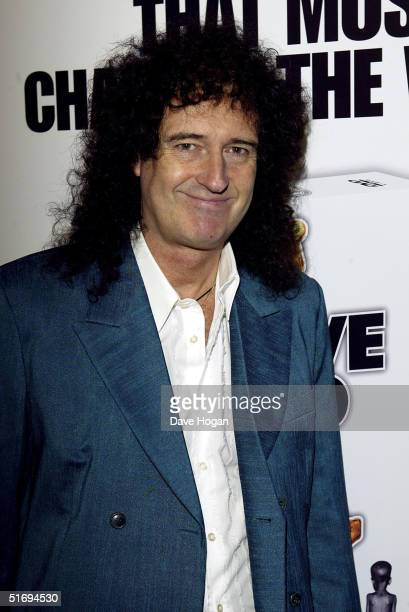 Musician Brian May arrives at the premiere screening of the new fourdisc DVD featuring 10 hours of footage from the historic charity concert Live Aid...