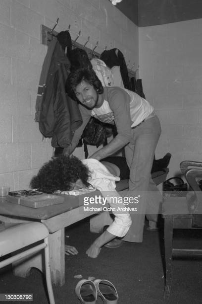 Musician Brian May of British rock band Queen gets a massage backstage circa 1977
