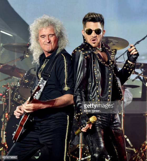 Musician Brian May of Queen and singer Adam Lambert perform at the Forum on July 3, 2014 in Inglewood, California.