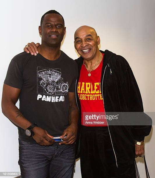 Musician Brian McKnight and Harlem Globe Trotter Curly Neal visit SiriusXM Studios on February 12 2013 in New York City