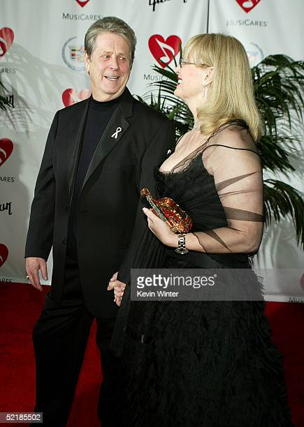 Musician Brian Wilson and his wife Melinda arrive at the MusiCares 2005 Person of the Year Tribute to Brian Wilson at the Palladium on February 11...