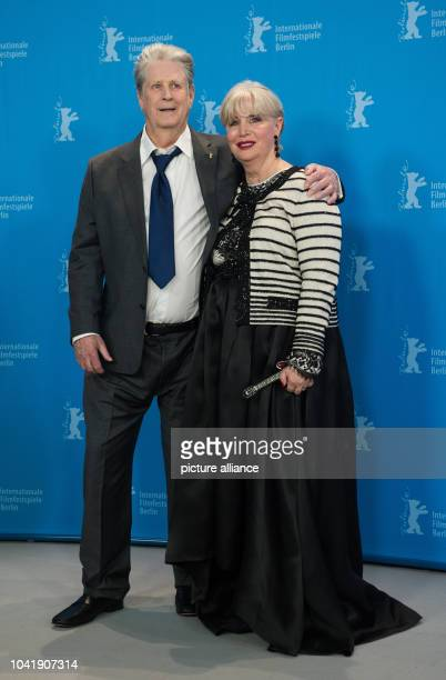 Musician Brian Wilson and wife Melinda Ledbetter attends the photocall of Love & Mercy during the 65th International Berlin Film Festival, Berlinale,...