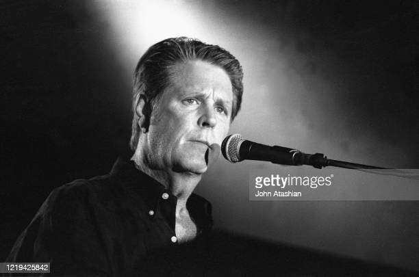 Musician Brian Wilson best known as the leader and chief songwriter of the Beach Boys is shown performing on stage during a live concert appearance...