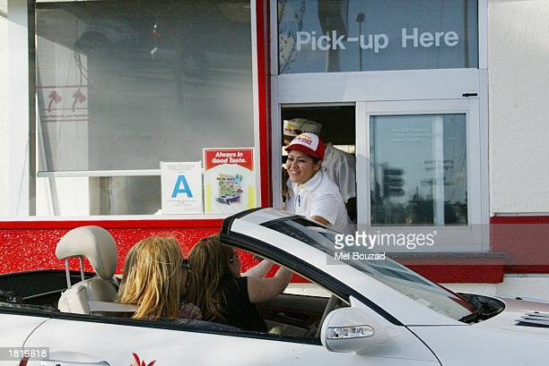 Musician Britney Spears and friend drive through InNOut Burger on February 27 2003 in Hollywood California