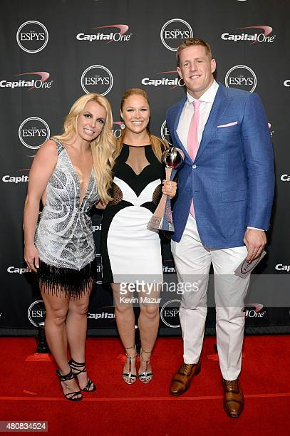 Musician Britney Spears with MMA fighter Ronda Rousey and NFL player JJ Watt posing with award for Best Female Athlete at The 2015 ESPYS at Microsoft...