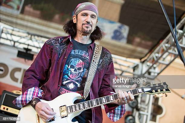 Musician Bruce Kulick of Grand Funk Railroad performs on stage at the San Diego County Fair on July 5 2014 in Del Mar California