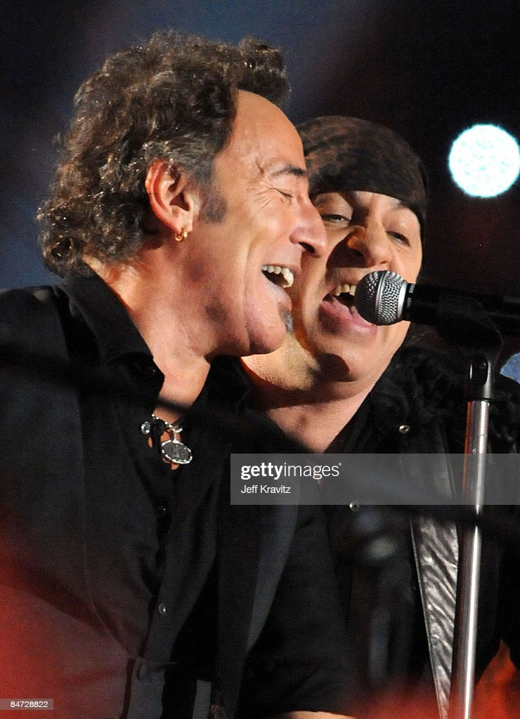 Musician Bruce Springsteen and Guitarist Steven Van Zandt of the E Street Band perform at the Bridgestone halftime show during Super Bowl XLIII between the Arizona Cardinals and the Pittsburgh Steelers on February 1, 2009 at Raymond James Stadium in Tampa, Florida.