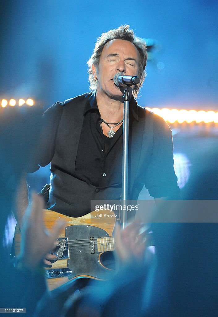 Musician Bruce Springsteen and the E Street Band perform at the Bridgestone halftime show during Super Bowl XLIII between the Arizona Cardinals and the Pittsburgh Steelers on February 1, 2009 at Raymond James Stadium in Tampa, Florida.