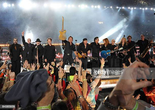 Musician Bruce Springsteen and the E Street Band perform at the Bridgestone halftime show during Super Bowl XLIII between the Arizona Cardinals and...