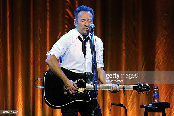 Musician Bruce Springsteen performs onstage during USC Shoah Foundation's 20th Anniversary Gala at the Hyatt Regency Century Plaza on May 7 2014 in...