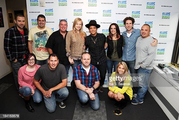 Musician Bruno Mars and the cast of The Elvis Duran Z100 Morning Show at Z100 Studio on October 15 2012 in New York City