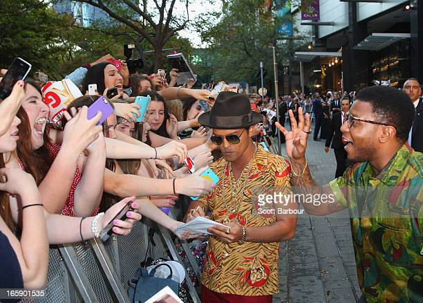 Musician Bruno Mars signs autographs for fans as he arrives at the 2013 Logie Awards at the Crown on April 7 2013 in Melbourne Australia