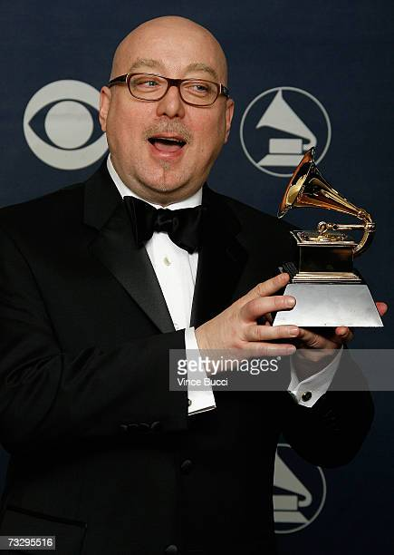 Musician Bryan Lynch poses in the press room with his Grammy for Best Latin Jazz Album 'Simpatico' at the 49th Annual Grammy Awards at the Staples...