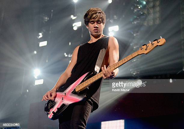 Musician Calum Hood of 5 Seconds of Summer performs onstage during KIIS FM's Jingle Ball 2014 powered by LINE at Staples Center on December 5 2014 in...