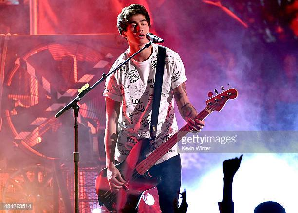 Musician Calum Hood of 5 Seconds of Summer performs onstage during the Teen Choice Awards 2015 at the USC Galen Center on August 16 2015 in Los...
