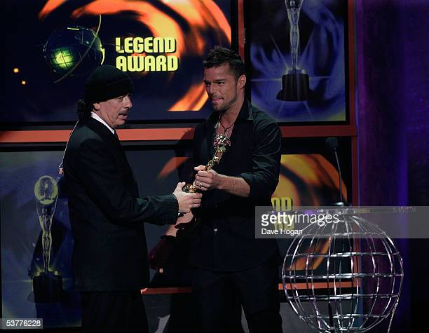 Musician Carlos Santana accepts the 'Legend Award' from Ricky Martin onstage at the 2005 World Music Awards at the Kodak Theatre on August 31 2005 in...