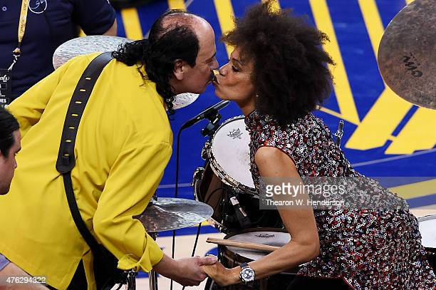 Musician Carlos Santana and his wife Cindy Blackman kiss prior to performing at Game Two of the 2015 NBA Finals between the Golden State Warriors and...