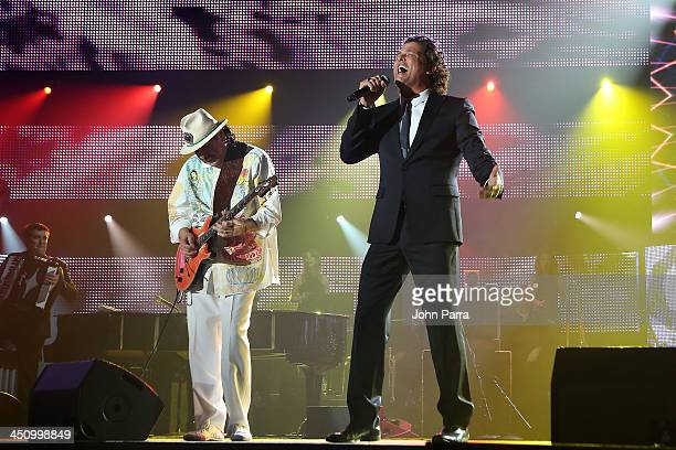Musician Carlos Santana and singer Carlos Vives perform onstage during the 2013 Person of the Year honoring Miguel Bose at the Mandalay Bay...