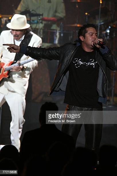 Musician Carlos Santana and vocalist Andy Vargas perform onstage at the Andre Agassi Charitable Foundation's 12th Annual Grand Slam for Children at...