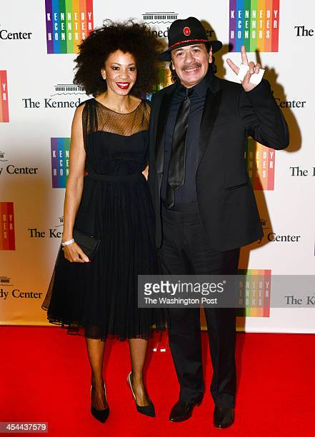 Musician Carlos Santana and wife Cindy Blackman arrive at a special dinner for Kennedy Center honorees and guests at the State Department in...