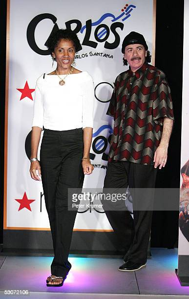 Musician Carlos Santana and wife Deborah Santana make an appearance at Macy's Herald Square to announce the launch of his new shoe collection Carlos...