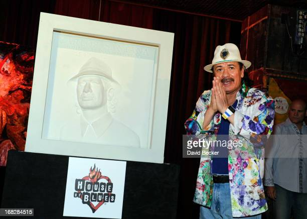 Musician Carlos Santana appears with a basrelief sculpture of himself during an unveiling at the House of Blues Las Vegas inside the Mandalay Bay...