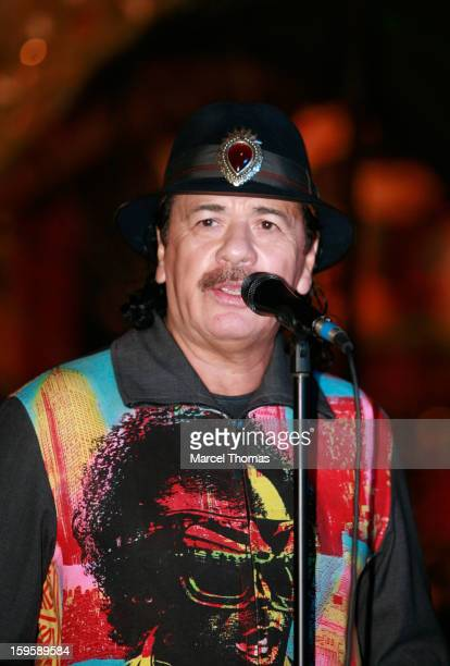 Musician Carlos Santana joins sculptor Dale Evers to unveil a commemorative guitar sculpture at House of Blues Las Vegas on January 16 2013 in Las...