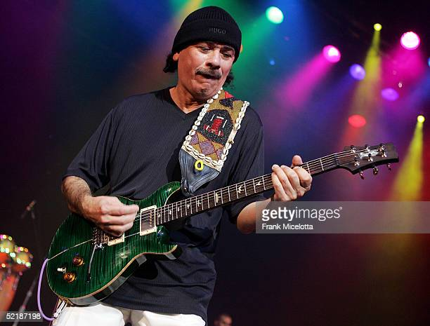 Musician Carlos Santana performs at the WillIAm Music Group launch and Tsunami Benefit concert on February 11 2005 at the Avalon in Hollywood...