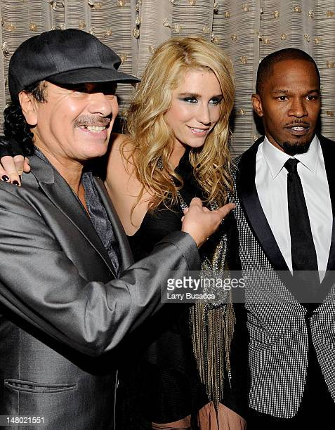 Musician Carlos Santana singer Ke$ha and singer Jamie Foxx during the 52nd Annual GRAMMY Awards Salute To Icons Honoring Doug Morris held at The...