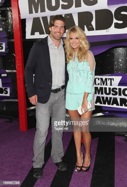 Musician Carrie Underwood and NHL hockey player Mike Fisher attend the 2013 CMT Music awards at the Bridgestone Arena on June 5 2013 in Nashville...