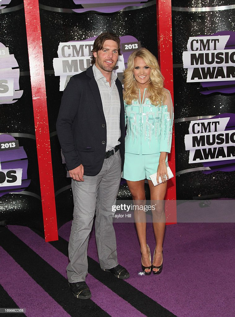 Musician Carrie Underwood (R) and NHL hockey player Mike Fisher attend the 2013 CMT Music awards at the Bridgestone Arena on June 5, 2013 in Nashville, Tennessee.