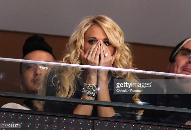 Musician Carrie Underwood reacts as she attends Game Five of the Western Conference Semifinals between the Nashville Predators and the Phoenix...